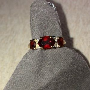 Solid gold, garnet and small diamond ring